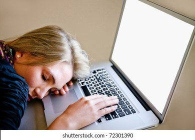 Tired woman sleeping over a laptop computer while working