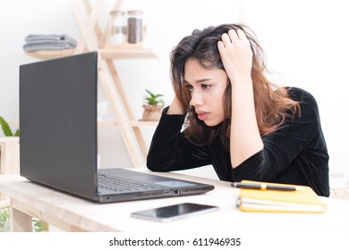 tired woman trying to focus on her work , stressed businesswoman with laptop at work