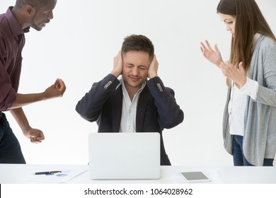 Tired from work or noise businessman closing ears with hands not to hear claims of annoying complaining clients, exhausted manager avoids bad work, suffers from headache or hates stressful job concept