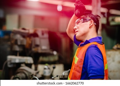 Tired worker, headache hot weather over heat unhealthy engineer working in heavy industry factory.