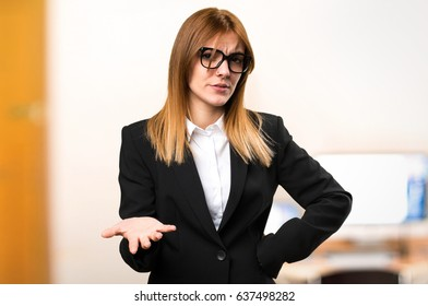 Tired young business woman on unfocused background