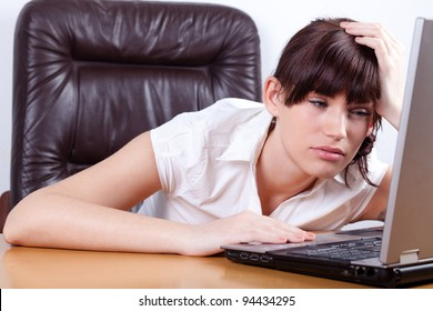 Tired young businesswoman falling asleep in her office