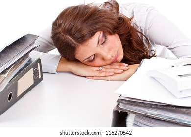 Tired young businesswoman sleeping on the table