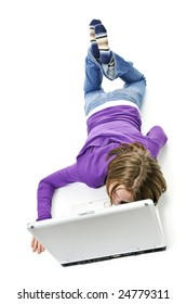 Tired young girl lying down asleep on laptop computer