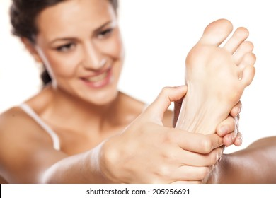 tired young woman massaging her feet