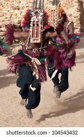 TIRELI, MALI - DECEMBER 30, 2009: Dogon tribes men dancing with their traditional mask on the main square of the village Tireli on December 30, 2009, Tireli, Mali.