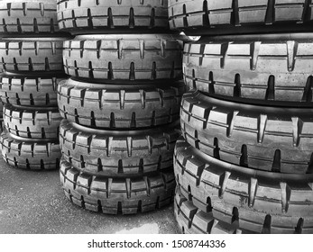 Tires for large cars and tractors close-up. Rubber lies in a row.