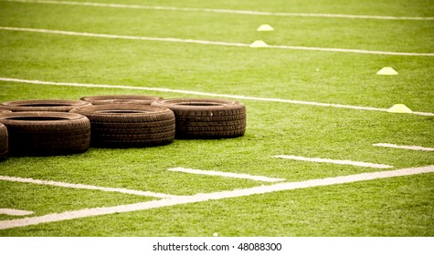 Tires On Football Field at Team Practicde