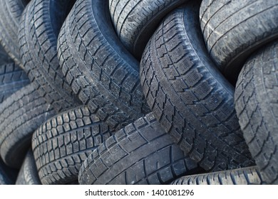 tires recycling rubber environment industry stacked car wheels