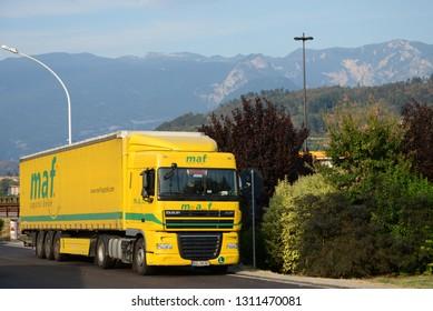 TIROL, AUSTRIA - AUGUST 18, 2013: DAF XF yellow Truck somewhere on the Austrian road.