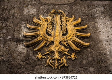 The Tirol coat of arms in gold on a stone background, found in Innsbruck, Austria.