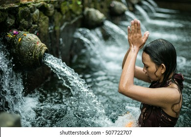 TIRTA EMPUL, Unidentified Woman pray and bath themselves in the sacred waters of the fountains, in Tirta Empul, Bali, Indonesia, on August 31, 2016.
