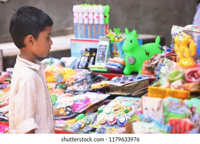 Tiruchendur,Tami nadu,India- 05-8-2018: Indian Little boy buying the Toys in Toy Shop
