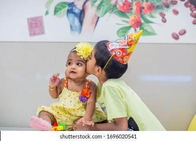 Tiruchirappalli, Tamil Nadu / India - February 7, 2020: first birthday - cute little girl baby celebrating first birthday with her brother