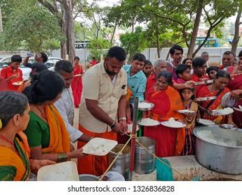 Tiruvanamalai, India -December 10, 2019:  Sadhus getting food in the Ramana Ashram in Tiruvanamalai in India