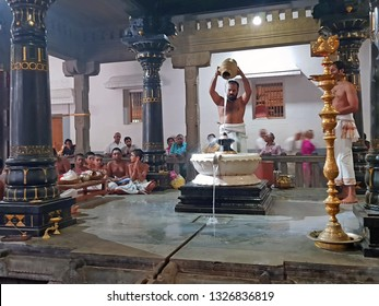 Tiruvanamalai, India -December 8, 2019:  Priest is doing pooja in the Ramana Ashram in Tiruvanamalai in India Asia
