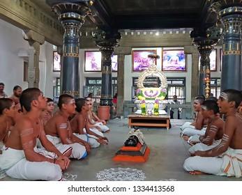 Tiruvanamalai, India -December 8, 2019: Young priests are singing in the Ramana Ashram in Tiruvanamalai in India Asia