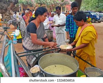 Tiruvanamalai, India -December 9, 2019:  Beggars and Sadhus getting food in the Ramana Ashram in Tiruvanamalai in India