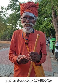 Tiruvanamalai, India - January 5, 2019: Begging Indian sadhu in the streets from Tiruvanamalai in India