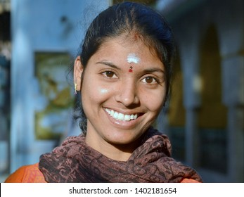 TIRUVANNAMALAI, TAMIL NADU / INDIA - FEB 14, 2016: Young Indian Tamil woman with beautiful eyes and white tilaka mark (third eye) on her forehead smiles for the camera, on Feb 14, 2016.