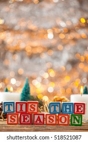 Tis The Season Written With Toy Blocks On Christmas Card Vertical Background With Copy Space.