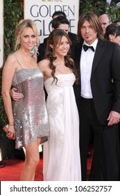 Tish Cyrus with Miley Cyrus and Billy Ray Cyrus at the 66th Annual Golden Globe Awards. Beverly Hilton Hotel, Beverly Hills, CA. 01-11-09