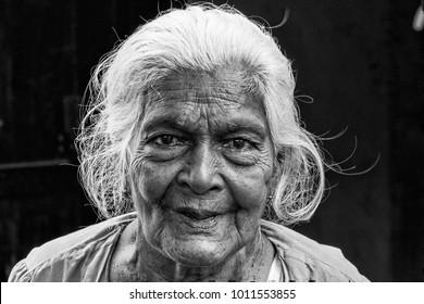 TISSAMAHARAMA, SRI LANKA. February 19, 2017: Grandmother on a market in Tissamaharama (monochrome)