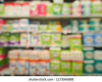 Tissue Department Store in Supermaket with Blurred background, Image blur of Tissue Department Store, Abstract blurred supermarket aisle and shelves with various toilet tissue paper display