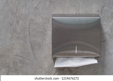 tissue paper on wall, toilet