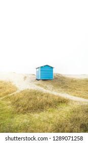 TISVILDE, DENMARK - MARCH 22, 2018: Little blue beach house by the beach in Tisvilde, Denmark.