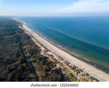 Tisvildeleje, Denmark - February 24, 2019: Aerial drone  view of the coastline beach, sand dunes and forest.