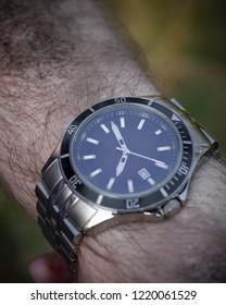 Titanium watch on a dirty hand