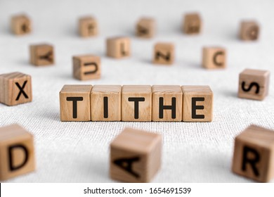 Tithe - words from wooden blocks with letters, one-tenth part tax to the Church tithe concept, white background
