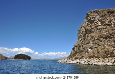TITICACA LAKE, BOLIVIA - SEPTEMBER 4, 2010 : Mountain lake Titicaca. Titicaca, the highest largest fresh water lake in South America , the highest navigable lake in the world.