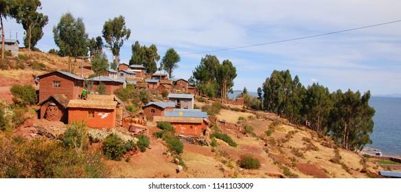 TITICACA LAKE PERU NOVEMBER 22 2010: Houses of Local Peruvian People Living on Taquile Island (Isla Taquile) at Lake Titicaca in Puno Peru.