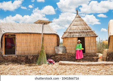 Titicaca lake, Puno, Peru - March, 20, 2017. Woman in traditional dresses on Uros floating islands on Titicaca lake in Puno, Peru, South America