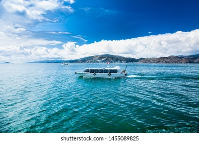 Titicaca, Peru- Jan 5, 2019: Traveling by boat at Titicaca lake near Puno, Peru, South America.