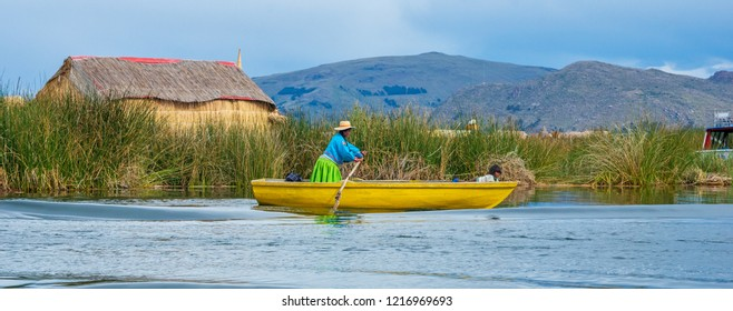 Titicaca, Peru, March 19, 2015: Woman on the boat on lake Titicaca. Traditional village on floating Uros islands. Peru, South America