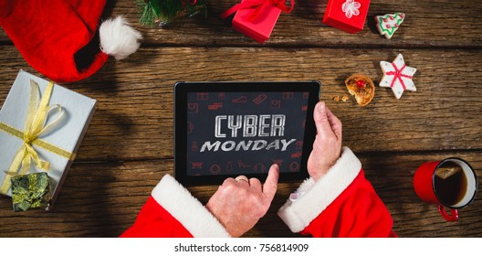 Title for celebration of cyber Monday  against santa claus using digital tablet on table