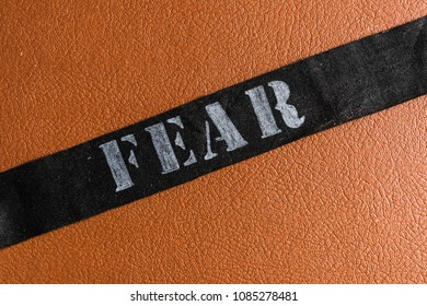 Title fear on the leather background