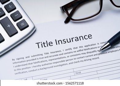 Title Insurance Form Near Calculator And Glasses