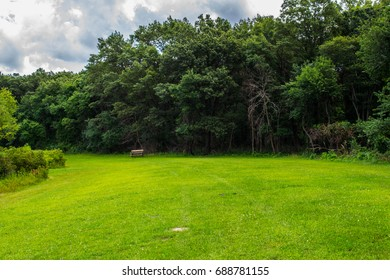 Title: Lonely Bench Description: Taken at Wampum Lake, a bench sits in the nice, smooth grass of the park.