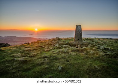 Titterstone Clee Hill, Shropshire, England. The third-highest hill in Shropshire. Trig point or triangulation station on the summit at sunset.