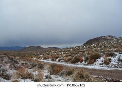 Titus Canyon road winding one way from Nevada to California in the Amargosa Mountains, Death Valley National Park on a snowy day in December