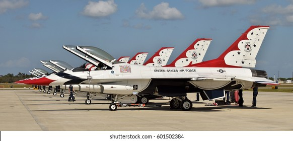 TITUSVILLE - MARCH 13: US Air Force Thunderbirds team makes a stop over in Titusville, Florida on March 13, 2017 on their way to an airshow. Pictured are a row of their F-16 aircraft.