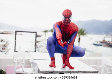 TIVAT, MONTENEGRO - AUG 4, 2015:  Cosplayer dressed as Spiderman in cafe of TIvat. Spider man is a fictional character created by Stan Lee
