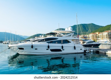 Tivat, Montenegro - June 28, 2021: Sunset view of the yacht marina in Porto Montenegro with waterfront residences and  the beautiful promenade