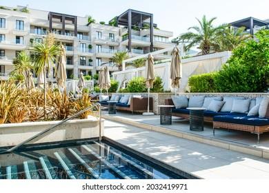 Tivat, Montenegro - June 29, 2021: Pool area in luxury modern hotel in Porto Montenegro Marina on the Adriatic coast