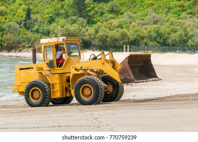 Tivat, Montenegro, May 11, 2017: Yellow excavator working on the river bank