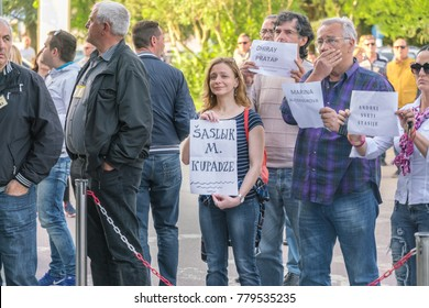 Tivat, Montenegro, May 11, 2017: Crowd of people meeting with signs outside the fence